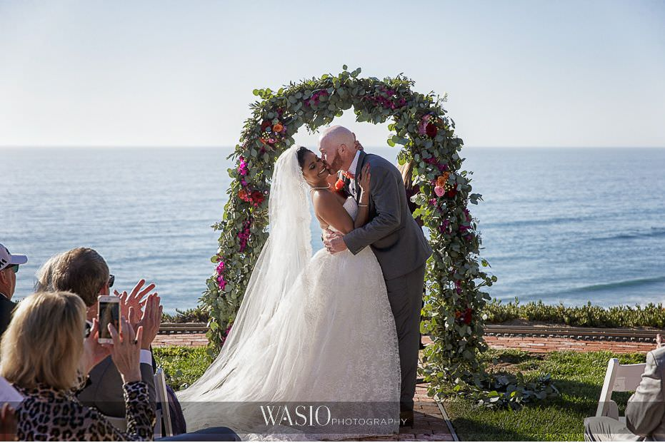 Del-Mar-Wedding-ceremony-custom-wreath-whimsey-florals-bride-groom-first-kiss-husband-wife-15 Del Mar Wedding By The Ocean - Shanie and James