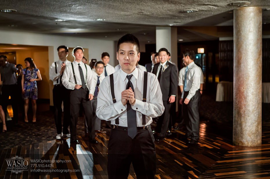 Destination-Chicago-Wedding-Photographer-WASIO-photography-0083-garter-toss-groom-931x620 A Beautiful Wedding at Victoria in the Park - Soy+Patrick
