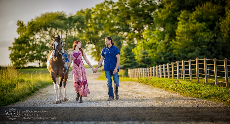 Horse-barn-engagement-holding-hands-walking-105-931x501 A horse barn engagement - Sarah + Jorge