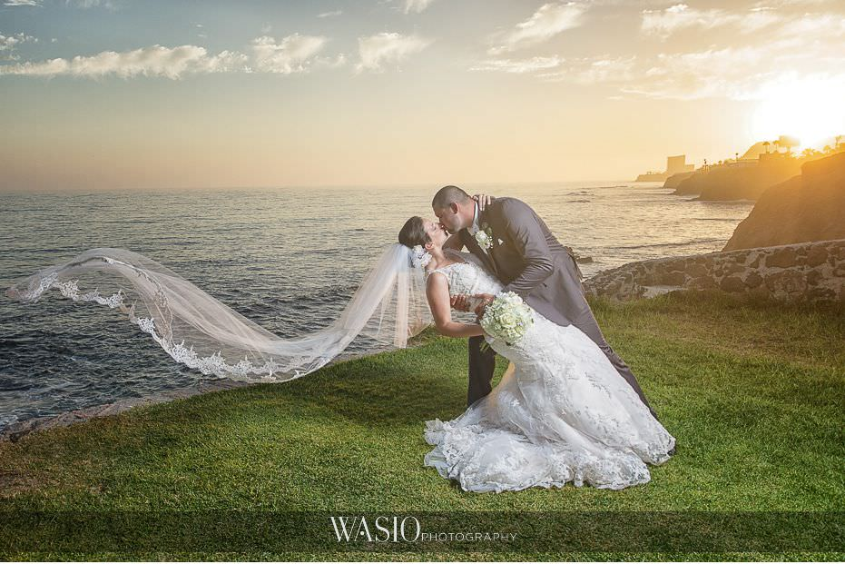 Las-Rocas-Resort-Rosarito-Wedding-bride-groom-flowing-veil-perfect-dip-sunset-kiss-portrait-baja-california-49 Las Rocas Resort Rosarito Wedding - Meaghan and Eric