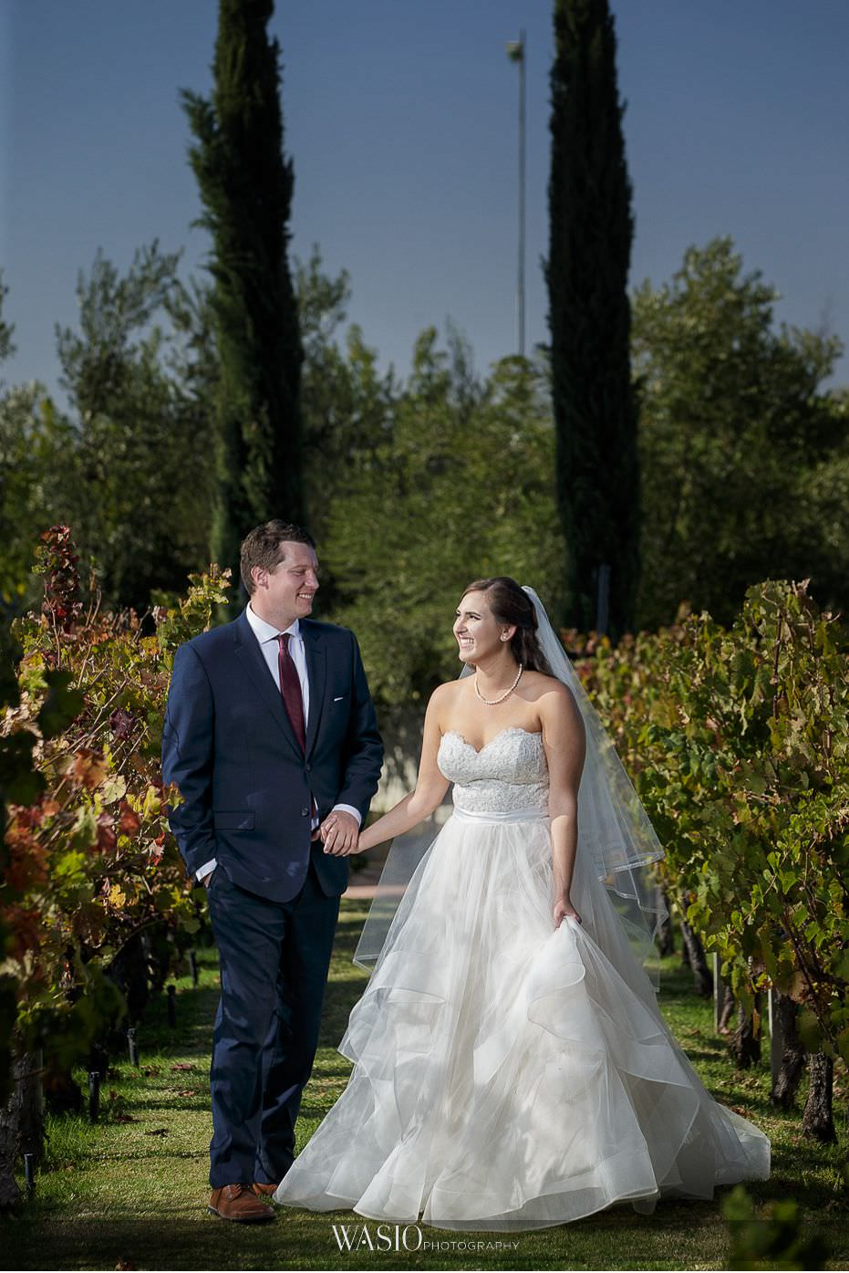 Mount-Palomar-Winery-Wedding-bride-groom-hand-holding-walking-winery-grapes-vineyard-outdoor-fall-colors-69 Mount Palomar Winery Wedding - Chelsea & Brandon