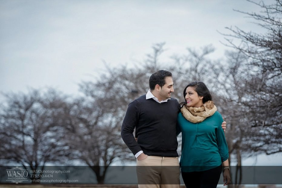Snowy-Chicago-Engagement-Session-walking-gazing-into-each-other-playful-cuddle-13-931x621 Snowy Chicago Engagement Session - Fatima + Asad