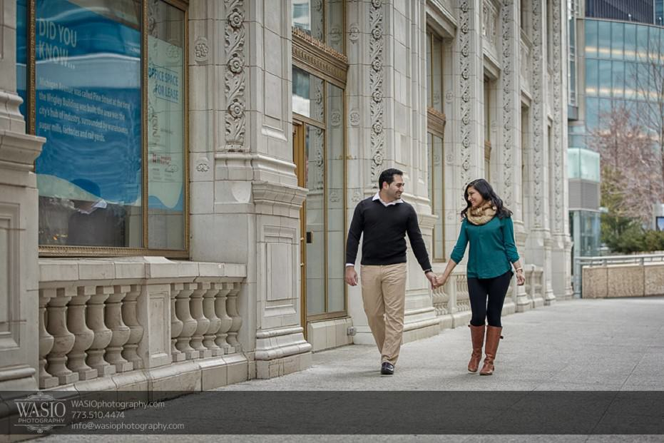 Snowy-Chicago-Engagement-Session-walking-hand-holding-flirt-laugh-beautiful-couple-river-walk-out-of-town-4-931x621 Snowy Chicago Engagement Session - Fatima + Asad