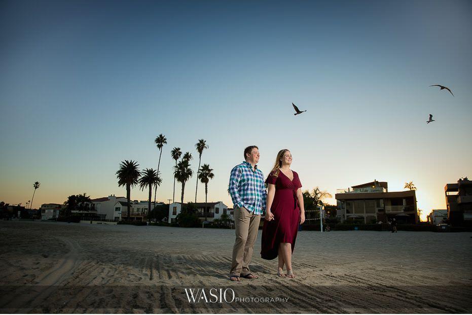 catamaran-resort-hotel-wedding-sunset-couple-portrait-holding-hands-flying-birds-beach-photo-san-diego-76 Catamaran Resort Hotel Wedding - Anna and Andy