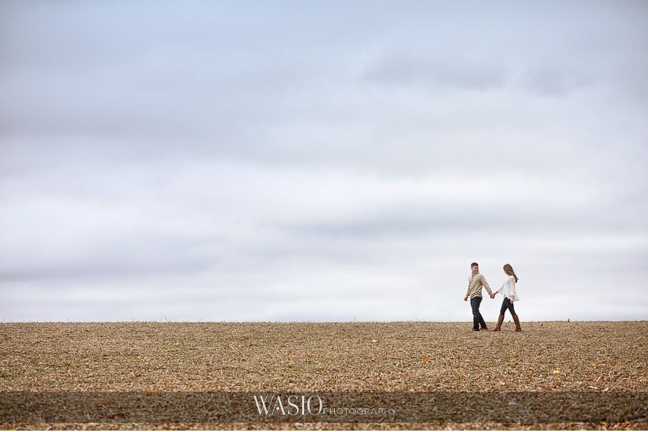 fall-engagement-pictures-landscape-portrait-dramatic-cloudy-sky-hand-holding-walking-farm-nature-87 The Most Romantic Fall Engagement Pictures - Julia and Luis